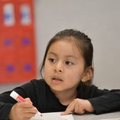 an image of a young girl in a classroom learning